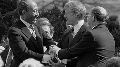U.S.  President Jimmy Carter grasps hands with Egyptian President Anwar Sadat and Israeli Prime Minister Menachem Begin at the White House signing of the peace treaty between the two nations on the grounds on March 26, 1979. Credit: U.S. News & World Report Magazine Photograph Collection/Library of Congress.