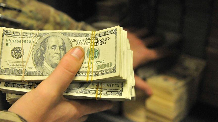 U.S. bills. Credit: Sgt. Sinthia Rosario/U.S. Army.