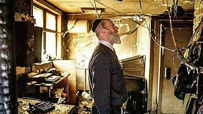 A rabbi examines damage to the Torat Chaim yeshivah, the largest yeshivah in Moscow, following an arson attack just hours prior to the Passover holiday on April 19, 2019. Courtesy: Torah Chaim.