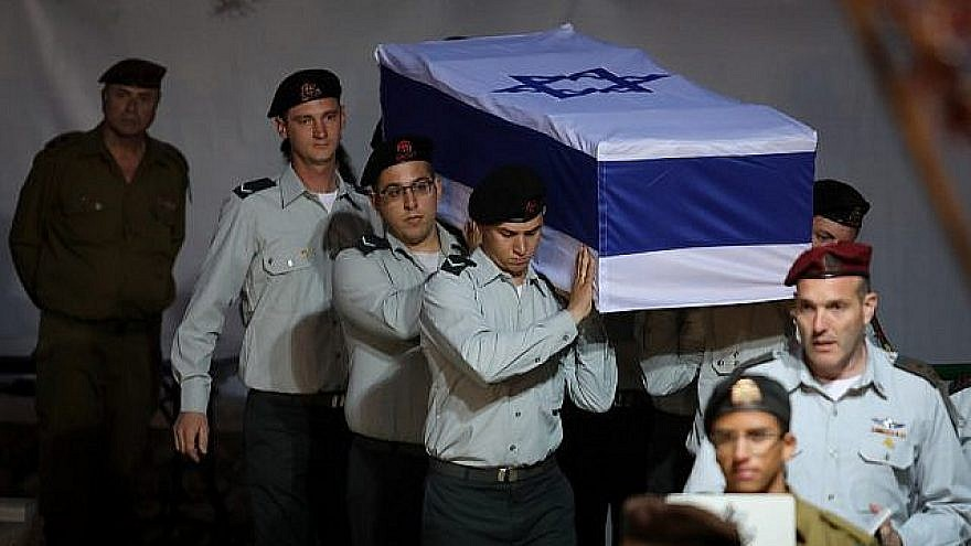 Israeli soldiers carry the coffin containing the remains of IDF soldier Sgt. First Class Zachary Baumel at the Mount Herzl Military cemetery in Jerusalem on April 4, 2019. Credit: Hadas Parush/Flash90.