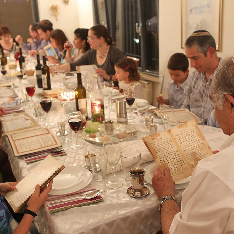 An Israeli family during the Passover seder on the first night of the holiday in Tzur Hadassah. Credit: Nati Shohat/Flash90.