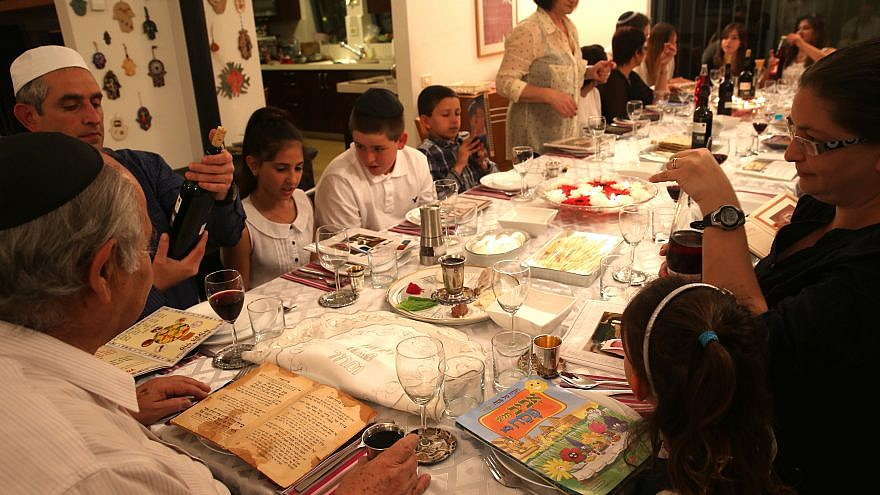 """An Israeli family seen during the """"Passover Seder"""" on the first night of the 8-day long Jewish holiday of Passover, in Tzur Hadassah. March 25, 2013 Credit: Nati Shohat/flash 90."""