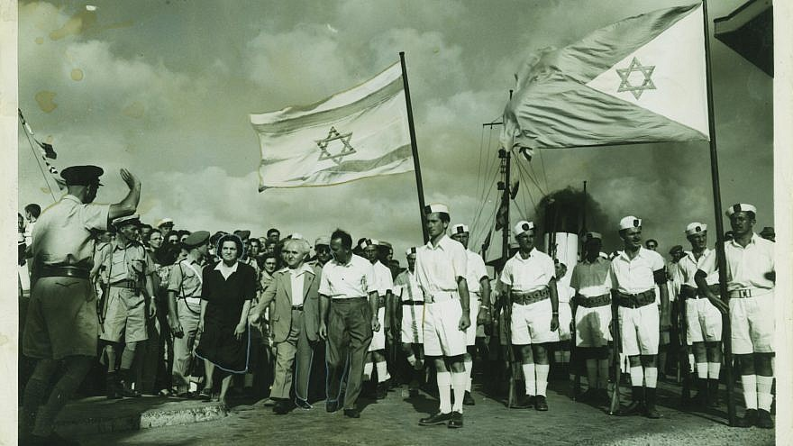 Arab troops at the port in Haifa surrendering to the Israel Defense Forces and Palyam (naval corps) soldiers, who were waving the Israeli and Navy flags at the port for the very first time. Credit: Kedem Auction House.