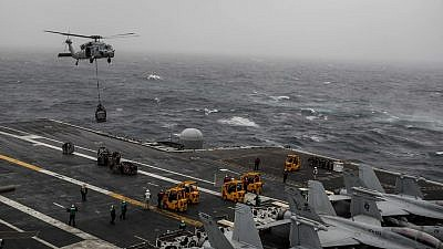 "The ""USS Abraham Lincoln"" takes on supplies. Credit: Garrett LaBarge/U.S. Navy."
