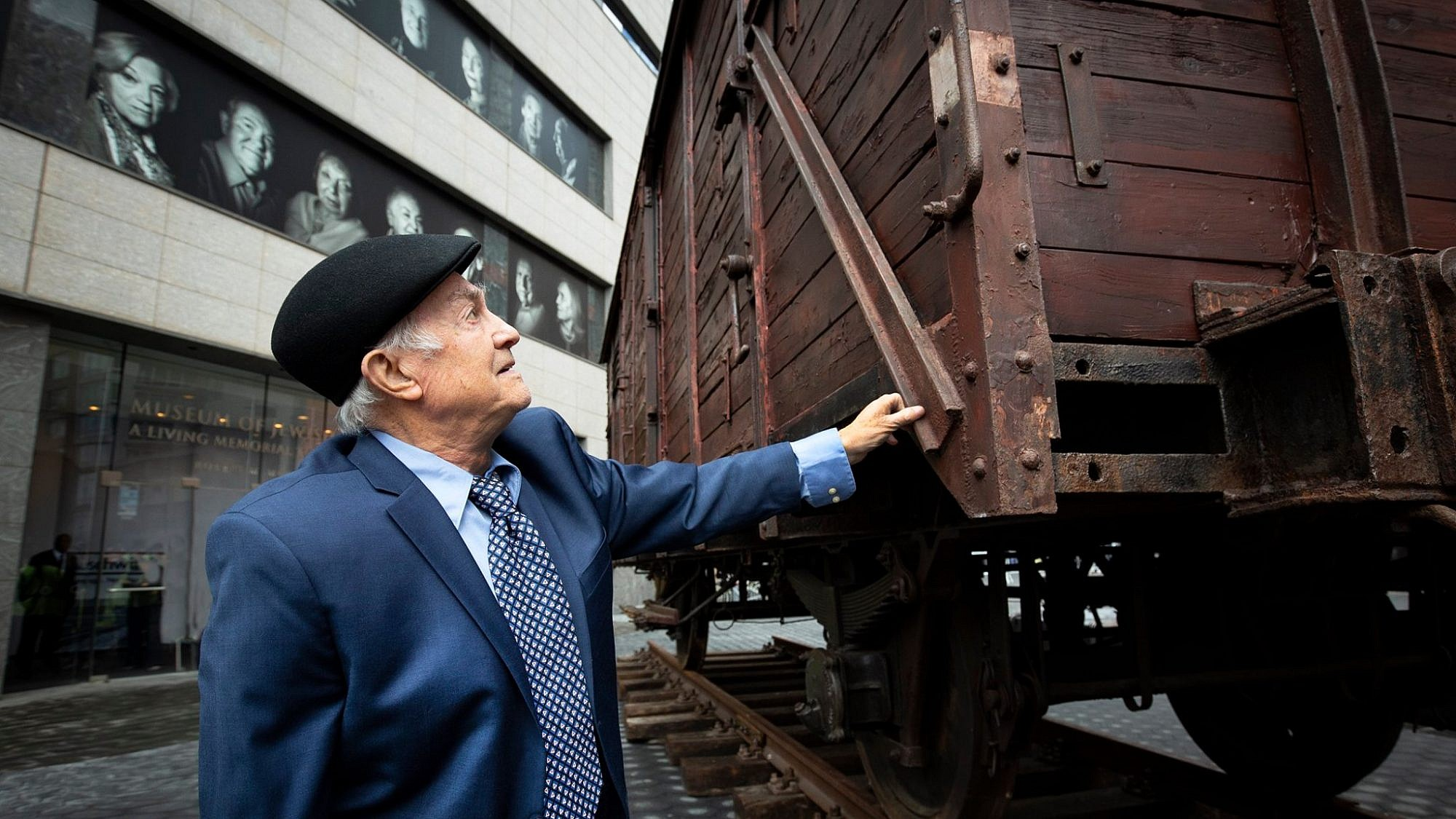 "A man inspects a restored World War II-era German freight car as part of the Museum of Jewish Heritage's exhibit: ""Auschwitz. Not long ago. Not far away."" Credit: Museum of Jewish Heritage via Facebook."