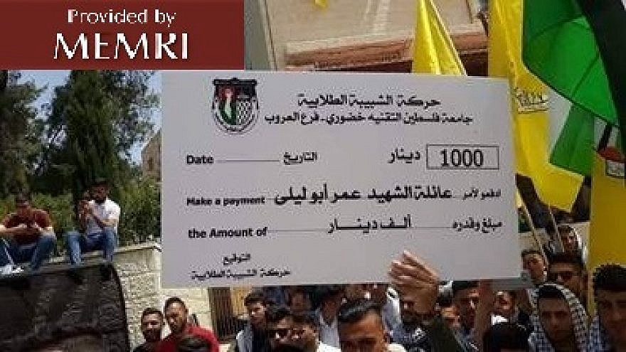Palestinian students display a check for 1,000 Jordanian dinars. The money was raised toward the rebuilding of the home of terrorist Omar Abu Laila, who murdered two Israelis in March. (MEMRI)
