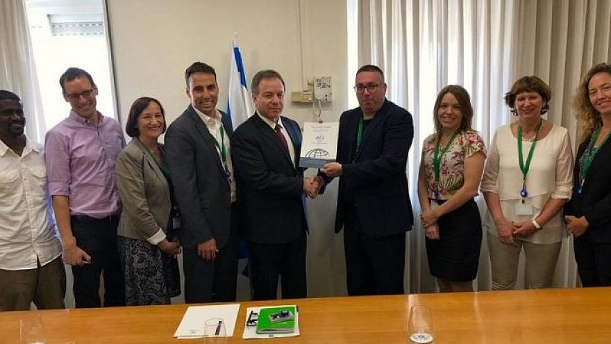 Director of the Society for International Development Israel Alon Beer, center right, presents the chief of staff of Israel's Prime Minister's Office, Yoav Horowitz, center left, with research on expanding Israel's international-development activity, May 15, 2019. Photo by Ariel Kahana/Israel Hayom.
