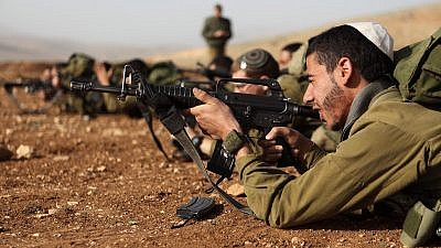 Israeli soldiers in the Nahal Haredi unit seen during a shooting exercise at the Peles Military Base in the northern Jordan Valley. Photo by Yaakov Naumi/Flash90.