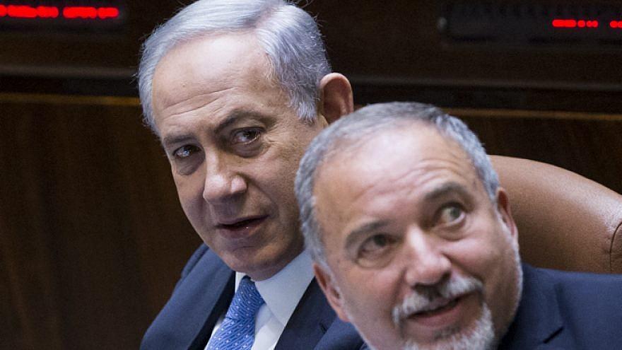 Israeli Prime Minister Benjamin Netanyahu and then-Defense Minister Avigdor Lieberman at the Knesset on June 1, 2016. Photo by Yonatan Sindel/Flash90.