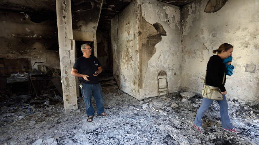 An Israeli woman reacts inside her burnt house, hit by a massive fire in the city of Haifa, Israel on November 25, 2016. Photo by Gili Yaari /Flash90.