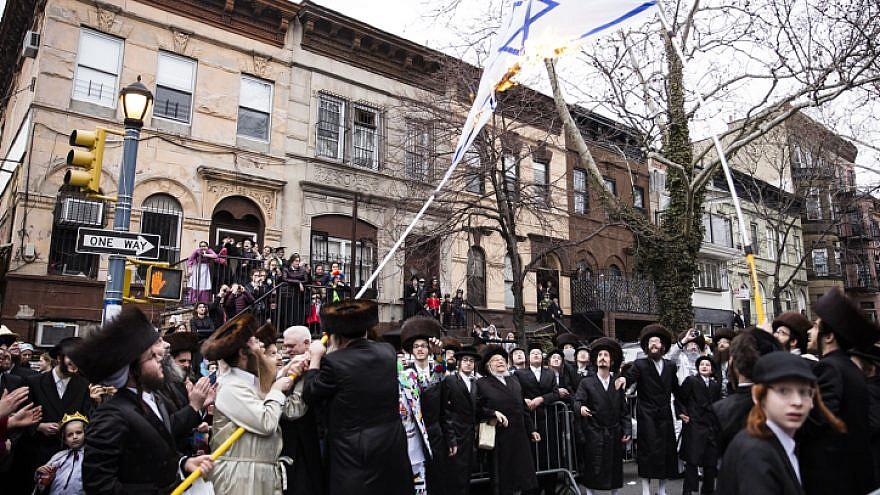 Haredi Jewish men burn an Israeli flag in the Williamsburg section of Brooklyn, N.Y., on March 1, 2018. Photo by Amir Levy/Flash90.