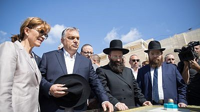 Hungarian Prime Minister Viktor Orbán (second from left) in Old CityJerusalem on the last day of a two-day official state visit to Israel. To his right is Rabbi Shmuel Rabinowitz, and to the right of him is Hungarian Rabbi Shlomo Koves. July 20, 2018. Photo by Yonatan Sindel/Flash90.
