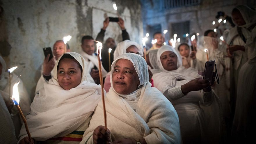 Ethiopian Orthodox Christian worshippers hold candles outside Deir Al-Sultan in the Church of the Holy Sepulcher during the ceremony of the Holy Fire in Jerusalem's Old City, Saturday, April 27, 2019. Photo by Noam Revkin Fenton/Flash90.