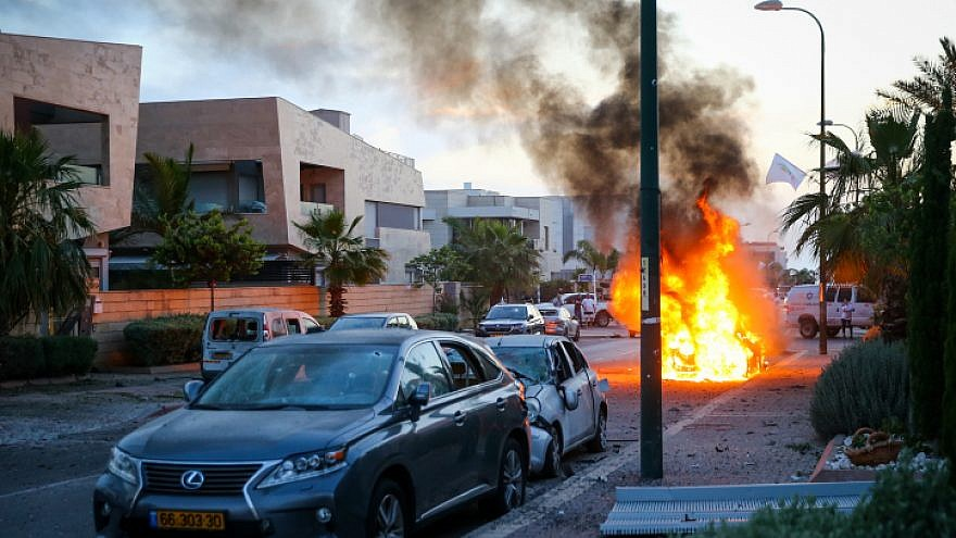 A car bursts into flames in Ashdod after being hit by a rocket fired from the Gaza Strip on May 5, 2019. Credit: Flash90