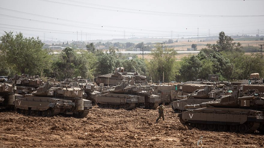 File photo: Israeli soldiers seen near IDF tanks stationed near the Israeli border with Gaza on May 6, 2019. Credit: Aharon Krohn/Flash90.