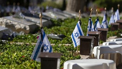 Israeli flags placed by each grave in the military cemetery of Netanya, ahead of the Israel's Memorial Day for fallen soldiers and victims of terror, on May 7, 2019. Photo by Flash90.