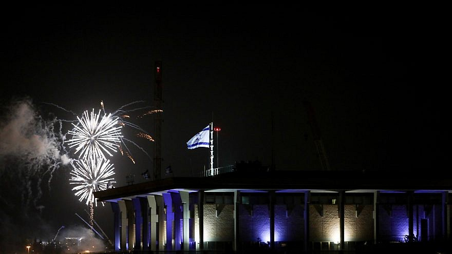 Fireworks from the Mount Herzl ceremony seen over the Knesset in Jerusalem, marking the beginning of celebrations for Israel's 71st Independence Day, May 8, 2019. Credit: Noam Revkin Fenton/Flash90.