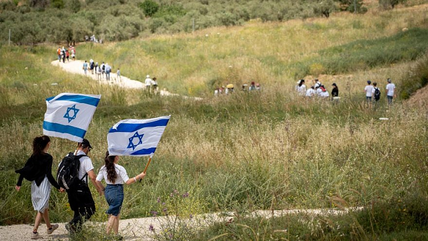 Israelis participate in a march to celebrate Israel's 71st Independence Day near Havat Gilad in Judea and Samaria on May 9, 2019. Photo by Hillel Maeir/Flash90.