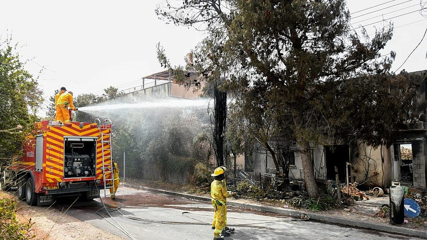 Firefighters extinguish the remains of a fire in in moshav Mevo Modi'im on May 24, 2019. Photo by Avi Dishi/Flash90.