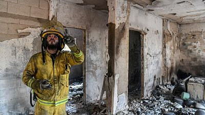 Fire fighters extinguish the remains of a fire in in Mevo Modi'in, on May 24, 2019. Photo by Avi Dishi/Flash90.