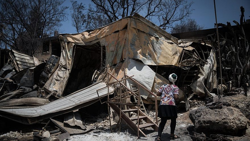 Residents check what is left of their homes after wildfires wiped out most of the houses last week in Mevo Modi'im, near the Ben Shemen Forest, on May 26, 2019. Credit: Hadas Parush/Flash90.
