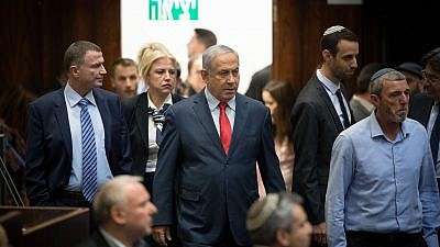Israeli Prime Minister Benjamin Netanyahu with Israeli parliament members during a vote on a bill to dissolve the Knesset in Jerusalem on May 29, 2019. Credit: Yonatan Sindel/Flash90.