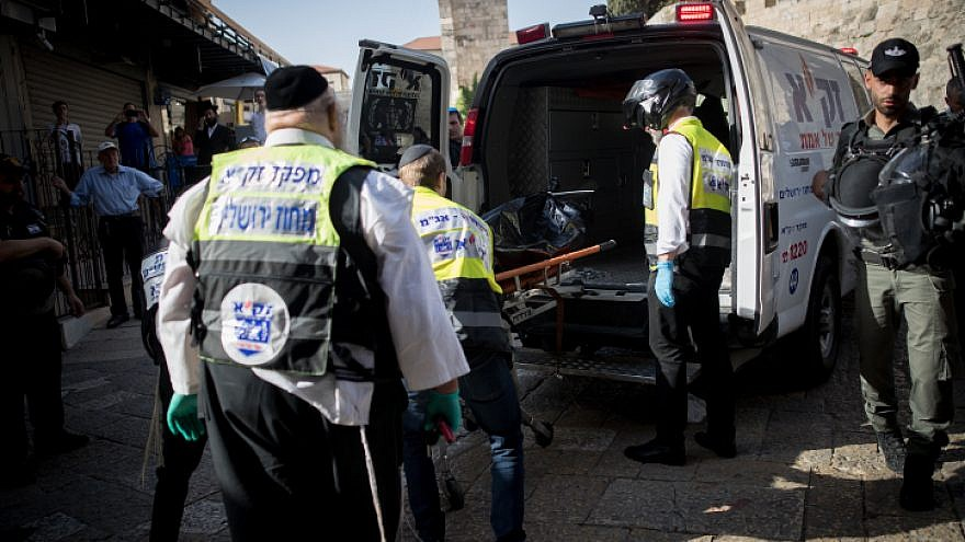 Israeli security forces and medics remove the body of a Palestinian man who stabbed two Israelis in the Old City of Jerusalem, on May 31, 2019. The attack occurred as Muslims marked the last Friday of the month of Ramadan. Photo by Yonatan Sindel/Flash90.