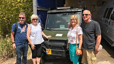 An ICEJ delegation visited Israeli communities along the Gaza border and viewed a new specially designed ATV security vehicle donated through the ICEJ to a local moshav. Credit: ICEJ.