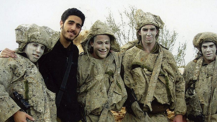Itay Steinberger (in black) posing with fellow IDF soldiers. Credit: Courtesy.