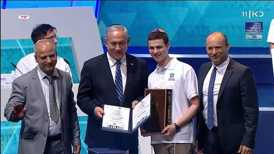Jacob Colchamiro of Short Hills, N.J., who placed second in the world, is pictured with Israeli Prime Minister Benjamin Netanyahu. Credit: Screenshot.