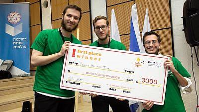 "The winning team of third-annual ""Great Minds"" men's hackathon at the Jerusalem College of Technology, Brazilians Daniel Vofchuk, David Zimberknopf and Daniel Grunberger. Photo by Michael Erenburg."