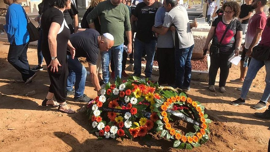 Mourners lay wreaths at the grave of Moshe Agadi, who was killed as a result of rockets launched into Israel from the Gaza Strip, on May 5, 2019. Photo by Avi Cohen.