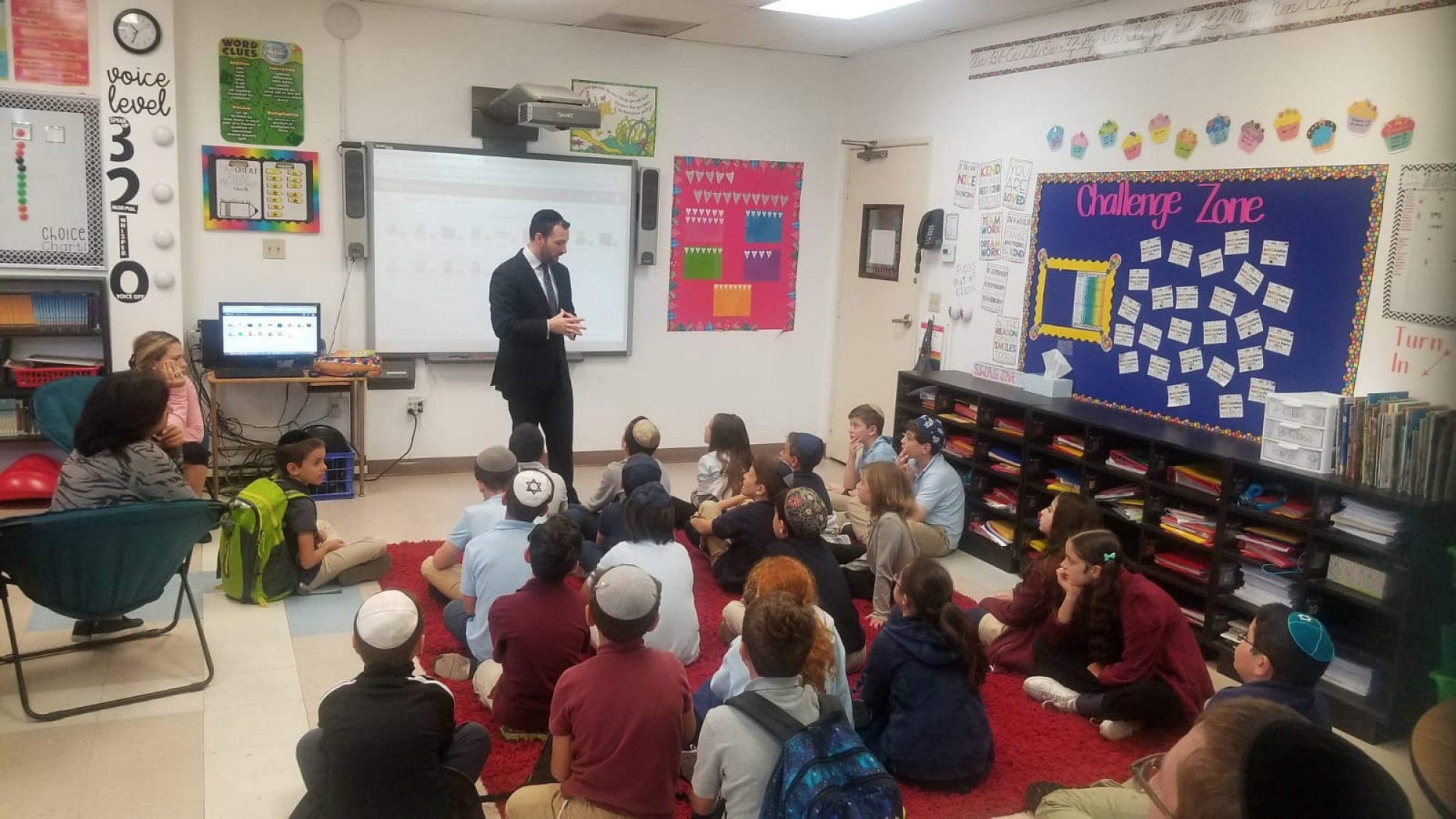 Rabbi Dr. Ari Sytner, a crisis-response counselor and director of community initiatives at Yeshiva University, provides San Diego-area Jewish day-school students with on-the-ground counseling following the shooting at Chabad of Poway in Southern Caliornia on April 27, 2019. Credit: Courtesy.