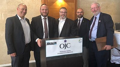 Duvi Honig (second from left), founder and CEO of the Orthodox Chamber of Commerce at the Anglo-Israeli/American Jerusalem Expo and Conference. Credit: Orthodox Jewish Chamber of Commerce.