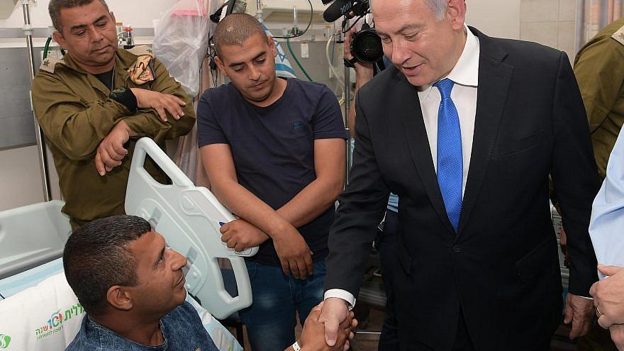 Israeli Prime Minister Benjamin Netanyahu visits IDF wounded soldiers at Soroka Medical Center in Beersheva. Credit: Amos Ben-Gershom/GPO.