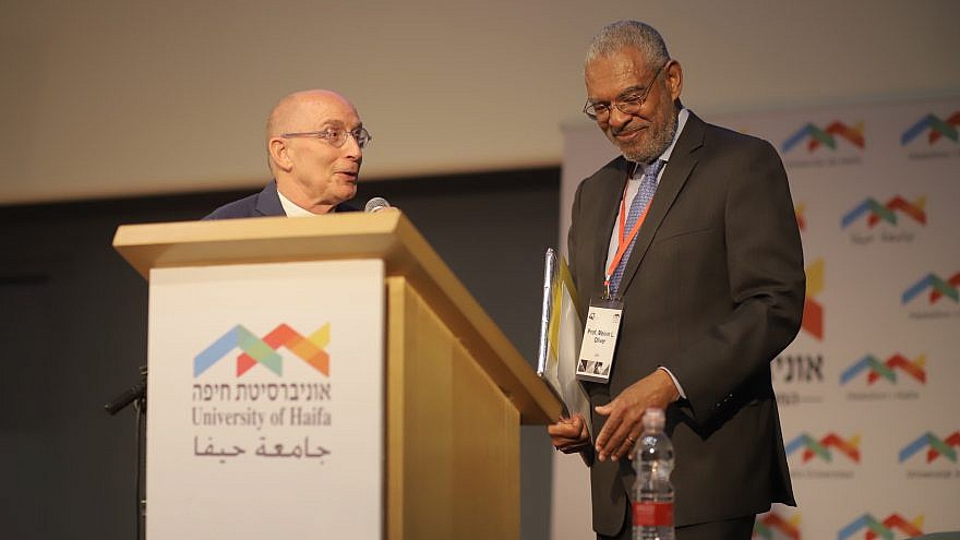 Pitzer College president Melvin Oliver (right) and University of Haifa president Ron Robin at Haifa's 47th annual board of governors meeting. Credit: University of Haifa.