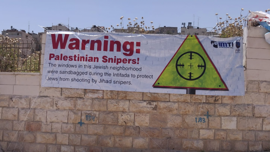 A poster in Hebron, created by the Jewish community of Hebron and the Im Tirtzu organization to combat the narrative of Breaking the Silence, May 2019. Credit: Yishai Fleisher.