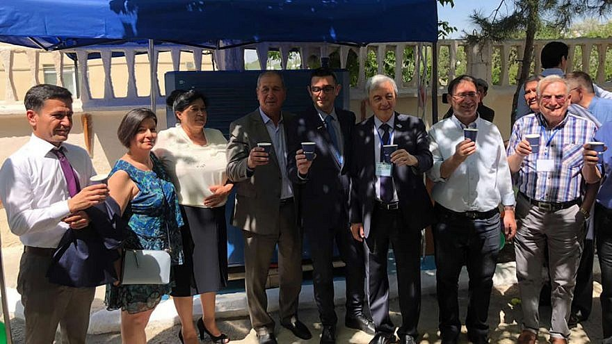 """Senior political leaders at the inauguration ceremony of the """"GEN-350,"""" which creates clean water out of air, in Bukhara, Uzbekistan. May 2019. Credit: Watergen."""