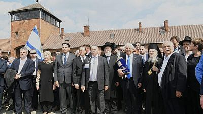 Dr. Shmuel Rosenman, founder and co-chairman of March of the Living, is flanked by Israel's Ambassador to the United Nations Danny Danon; Jewish Agency chair Isaac Herzog; U.S. Ambassador to Israel David Friedman; and a delegation of U.S. ambassadors and White House representatives headed by Friedman, including former Israeli Chief Rabbi Israel Lau, and Ecumenical Patriarch Bartholomew I, Archbishop of Constantinople, at the entrance to Birkenau during the 31st annual March of the Living. Credit: March of the Living.