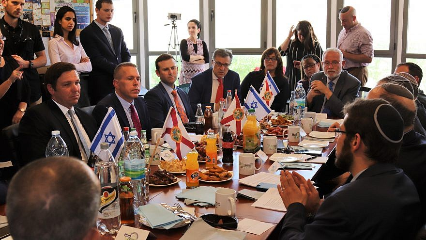 Florida Gov. Ron DeSantis (left) meets with Israeli Strategic Affairs Minister Gilad Erdan, as well as small-business owners and community leaders, at the Hub Etzion co-working space and small-business center in Gush Etzion on May 29, 2019. Credit: Shannon Nuszen.