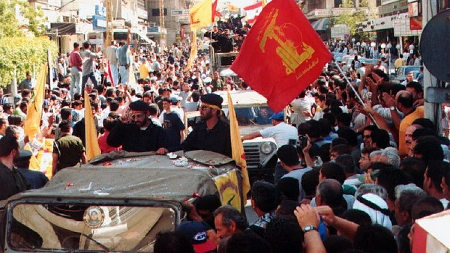 Hezbollah militants and supporters at a parade following the end of Israel's occupation of southern Lebanon in May 2000. Credit: Khamenei.ir via Wikimedia Commons.