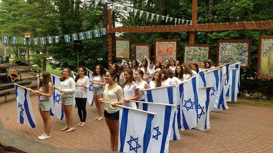 Campers celebrate Israel Day at Camp Yavneh in New Hampshire. Credit: Campy Yavneh via Facebook.