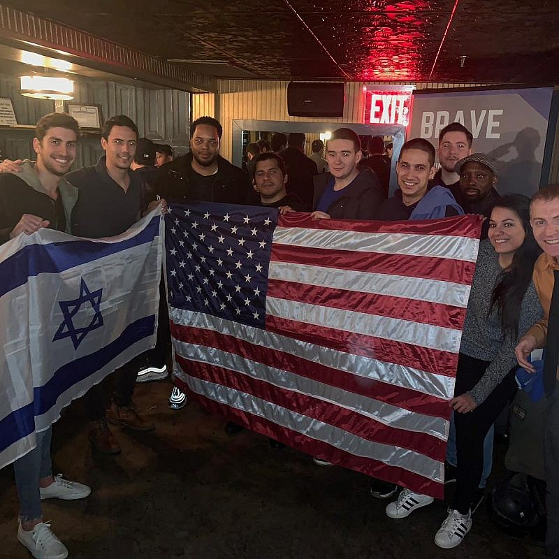 """U.S. and Israeli veterans attend a social function as part of the """"Brave"""" program that brings together vets to share stories, learn about the Jewish state and stand up against hatred and anti-Semitism on campus. Credit: Courtesy."""