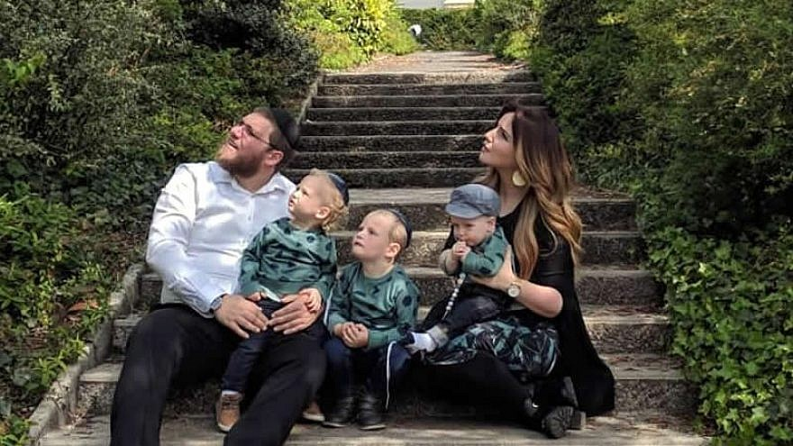 Rabbi Mordechai and Zlata Lewin, and their children, watch a military flyover in Normandy, France, site of the decisive Allied landing on D-Day that turned the tide of World War II. Credit: Chabad.org/News.