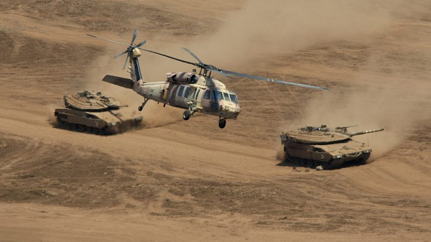 A Black Hawk helicopter and Merkava Tanks during an Israel Defense Forces drill in the the Golan Heights on Aug. 14, 2008. Photo by Moshe Shai/Flash90.