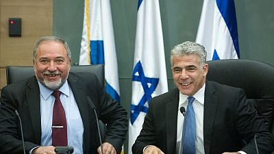 Yair Lapid and Avigdor Lieberman lead a joint conference in the Israeli parliament regarding Israel's foreign policy, Feb. 29, 2016. Photo by Miriam Alster/Flash90