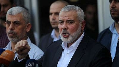 Hamas leader Ismail Haniyeh (right) speaks to the press in the southern Gaza Strip on Sept. 19, 2017. Photo by Abed Rahim Khatib/Flash90.