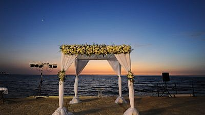 Illustrative photo of a Jewish wedding canopy in front of the Mediterranean Sea, Jan. 11, 2018. Photo by Mendy Hechtman/Flash90.
