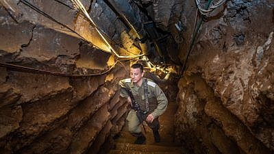 An Israeli soldier stands in a Hezbollah tunnel that crosses from Lebanon to Israel, on the border between Israel and Lebanon in northern Israel, on May 29, 2019. Photo by Basel Awidat/Flash90.