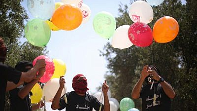 Palestinian youth prepare Molotov cocktails attached to balloons to fly towards Israel from the Gaza Strip, May 31, 2019. Photo by Hassan Jedi/Flash90.